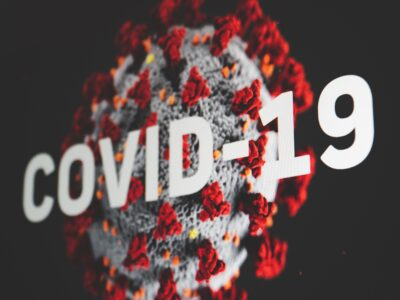coronavirus visualization with covid-19 word on screen hair loss