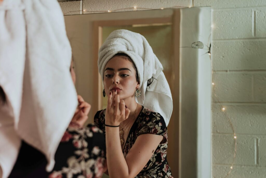 a woman doing skincare after shower
