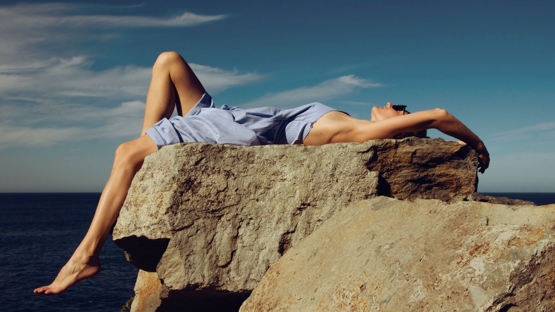 a woman lying under the sun